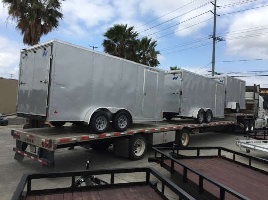 three Silver Haulmark Thrifty Hauler Delivery on a flatbed semi trailer at Norco Trailers