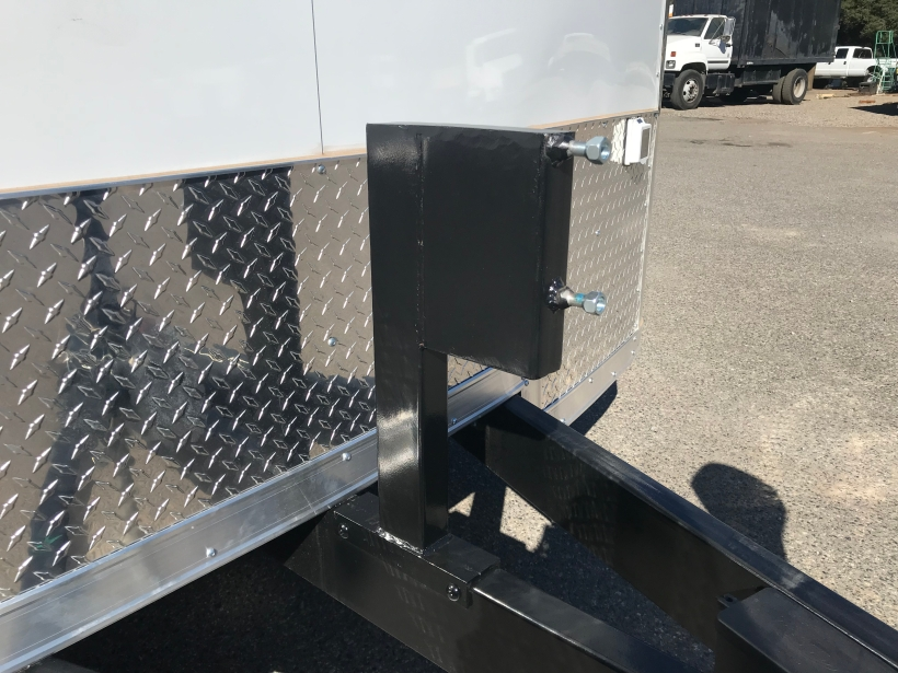 exterior mounted bolt-on spare tire mount on the center draw bar of trailer's extended tongue